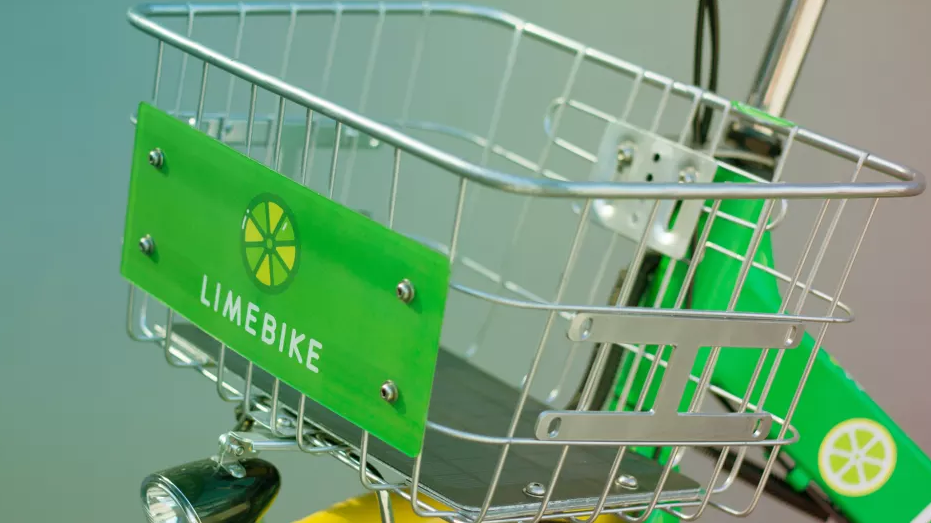 up close picture of lime bike logo on a basket of bicycle
