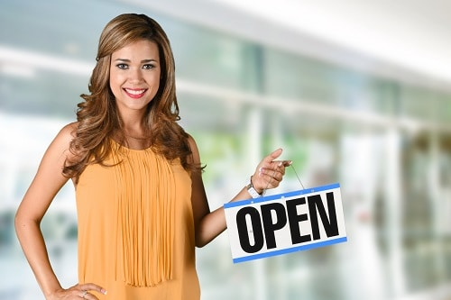 Woman Opening A Store