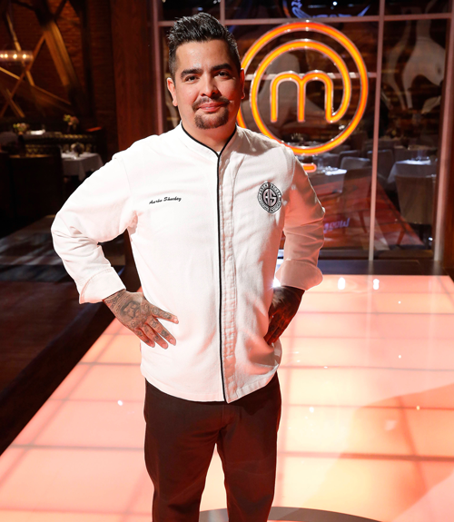 Chef Sanchez in his chef outfit on the Food Network stage