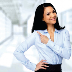 Professional woman standing smiling in office corridor
