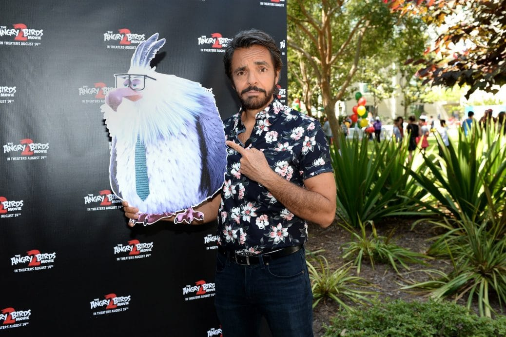 Eugenio Derbez having picture taken holding up an Angry Bird
