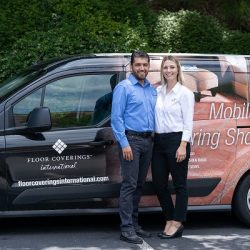 Jennifer & Jose Elias pose outside in front of of Floor Coverings International vehicle
