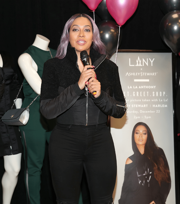 La La Anthony speaking on stage onstage about her clothing line