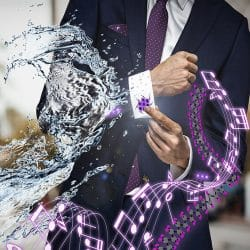 man wearing a suit being splashed with water