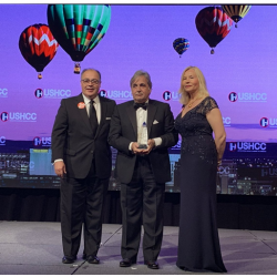 "President & CEO Raúl Alarcón accepts award on stage for ""2019 Businessperson of the Year"""
