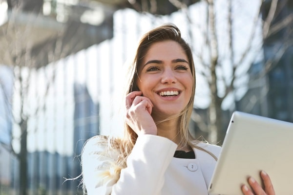 latina professional smiling while taking on cell phone