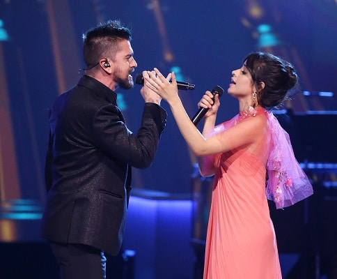 Juanes and Camillo Cabello perform on stage