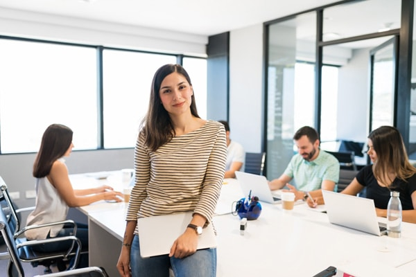 Confident Female Executive In Workplace