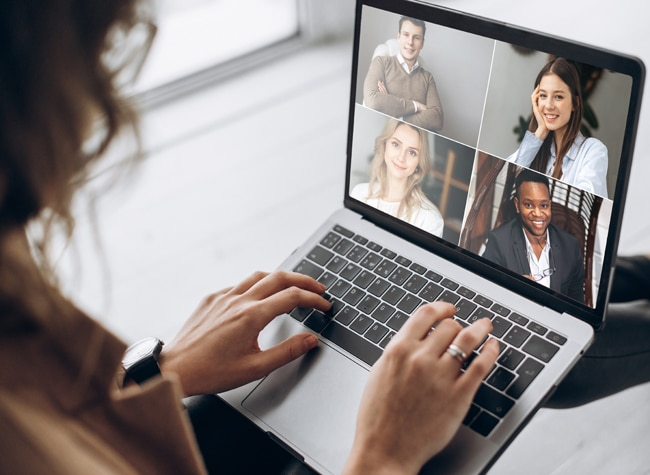 Remote team working from home in a video conference and manager communicates via video call communication with her team using laptop