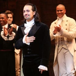 Lin-Manuel Miranda standing on stage as Alexander Hamilton